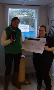 Blue Cross Volunteer  Pam Lee hands  Lorna Sheppard (Fundraising chair,)The cheque for £1000