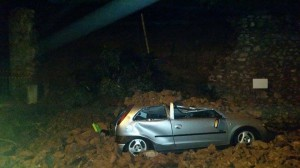 This car was crushed when the wall collapsed