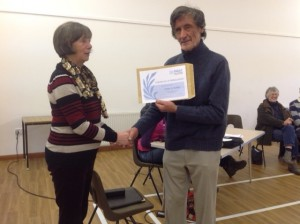 Cllr Gay Hill presents the certificate to Tony Colwill