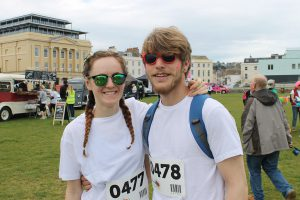 Libby Vanstone (left) who took part in The Colour Rush Teignmouth with Kai Radford (right)