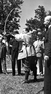 Extracts from a scrapbook centering around a visit the Royal British Legion made to Germany in 1951: Reception at Gorings place - shooting arrows