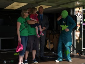 Lottie with her parents and green star man