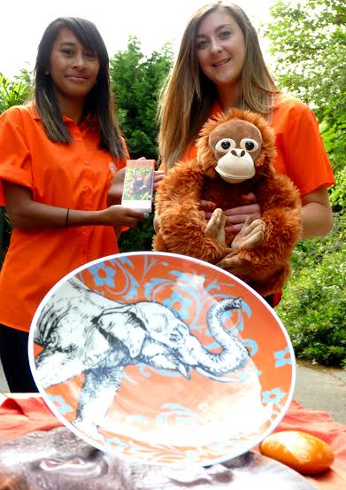 photographed with a selection of orange Fair Trade and palm oil free products are Shyla Uddin and Lauren Glover from Paignton Zoo