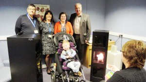 Audiology patient, Jeydan Fields, pictured with David Rogers (League Chair), Claire Rocket (Head of Audiology), Karen Fields (Jeydan's mum), Philip White (League Secretary) and Sandy Aze (Assistant Audiologist)