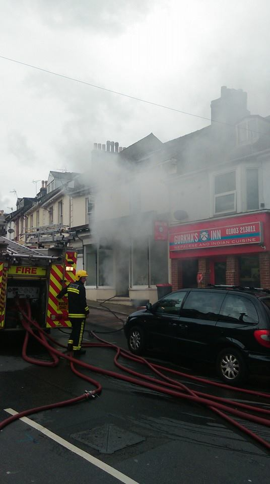 Smoke can be seen coming from the building. Photo: Andy Evans