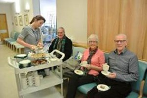 Patients and visitors on Torbay Hospital's Ricky Grant Unit enjoying their afternoon treats