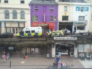 Police at the Mushroom shop on Wednesday