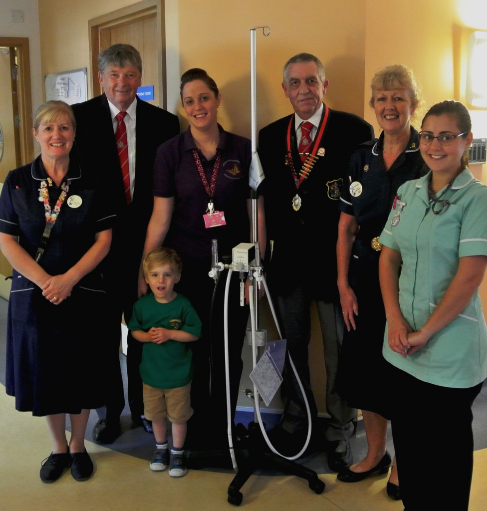 (from left to right): Sister Ruth Trengrove, Graham Heaven TAIBA acting chairman, patient Tommy, play assistant Cassie Vallance, TAIBA President Graham Warren, Matron Sandy Discombe and healthcare assistant Luisa Ramos