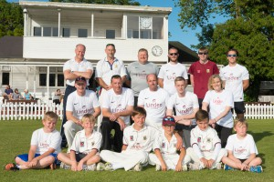 Linden Homes employees, headed up by Executive Chairman Greg Fitzgerald, with members of Torquay Cricket Club's junior