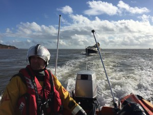 D class inshore lifeboat George Bearman towing the yacht to safety. (credit: Exmouth RNLI)