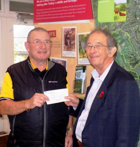 Mr Sandford receiving his cheque from TCCT chairman Alan Tyerman.