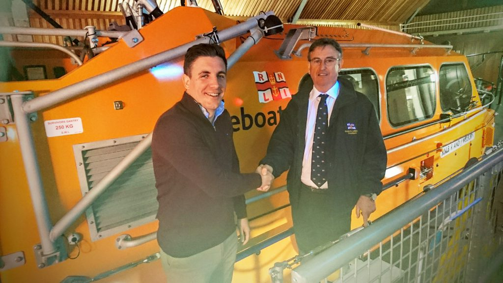 Photo: Exmouth RNLI Darryl Nicholas (left) succeeds Tim Baker (right) as Chair of the Exmouth Lifeboat Management Group.