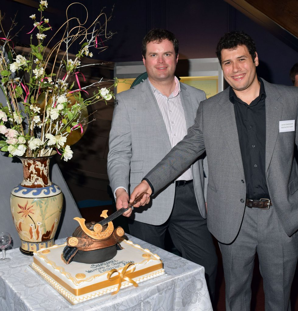 Kevin Foster MP and Martial Artists Expert Jamie Greenwood Cutting Samurai Cake