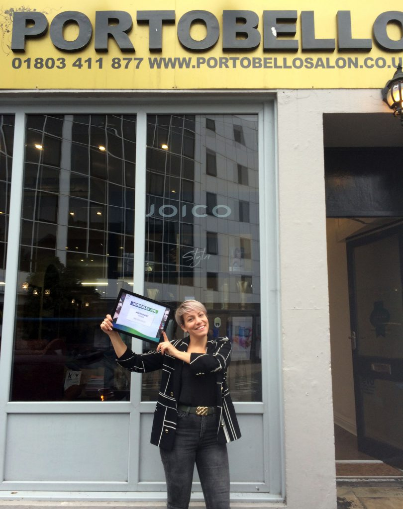 Melissa Hood from Torquay, proudly showing off her winner's certificate outside Torquay's Portobello Salon.