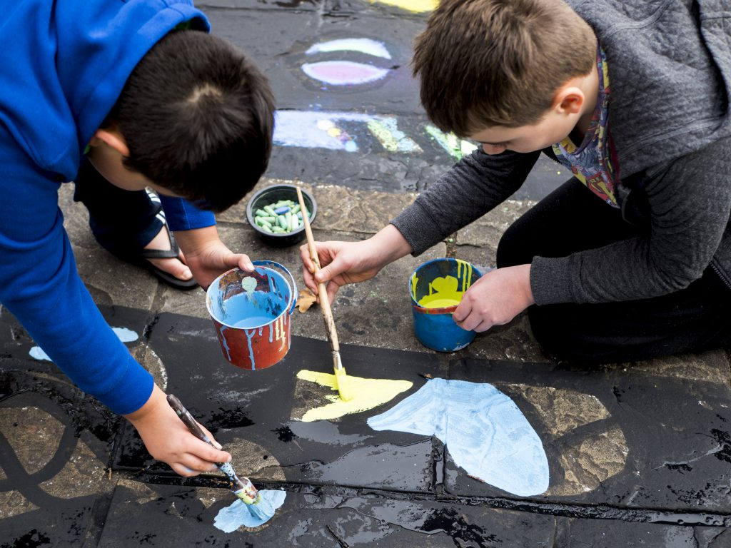 Children creating the Urban Canvas mural outside the town hall. Photo Credit Ryan Hardman